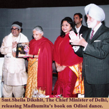 Smt.Sheila Dikshit, The Chief Minister of Delhi, releasing Madhumita's book on Odissi dance.